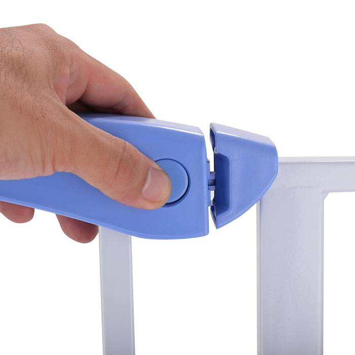 A hand is pressing buttons on extra large pet safety gate.
