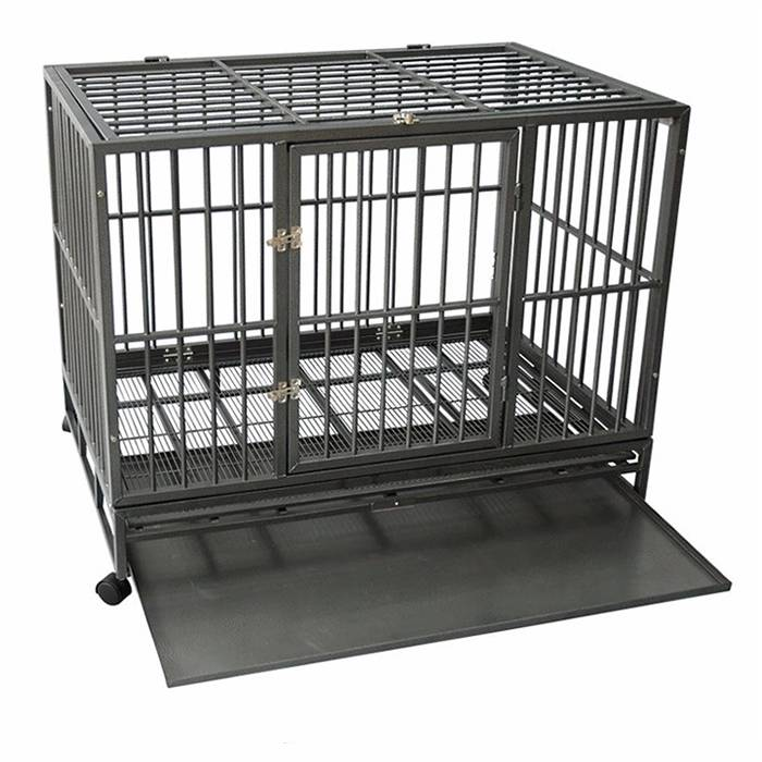 A heavy duty dog cage with wheel and the plastic pan is half sliding out.